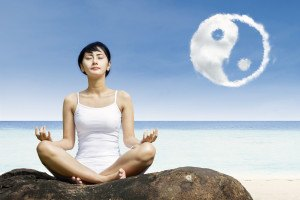 Beautiful girl meditate under yin yang cloud