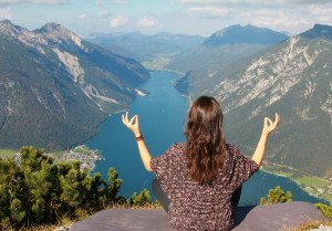 Young Woman Meditating At Mountain Top