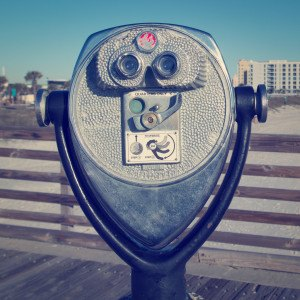 Coin binocular viewer at the beach with retro effect