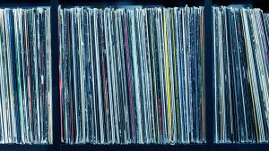 Stack of old vinyl records. blue tone