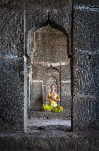 Woman doing meditation in the temple of Hampi Karnataka India ** Note: Visible grain at 100%, best at smaller sizes
