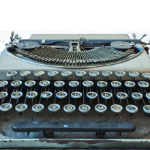 Old Antique typewriter keyboard isolated on white
