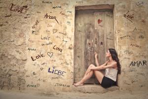 Girl writing on a wall